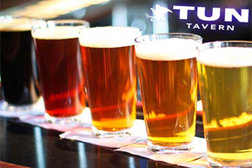 Tun Tavern variety of brews in pint glasses